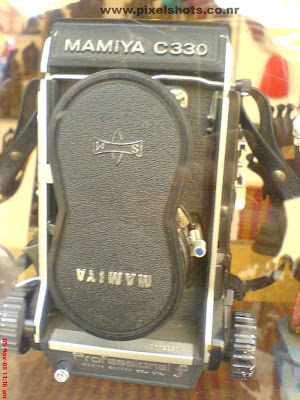 old film cameras of camera brand mamiya for sales in antiques shop in mattancherry jew street in india cochin kerala