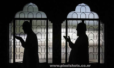 photograph of muslim people praying allah,scene from a mosque after the attacks on mumbai by terrorists