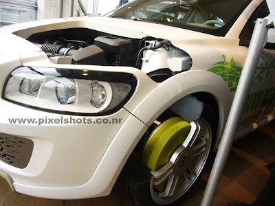 volvos electric car concept model shown in volvos auto show in india cochin,electric car engine and mechanisms demonstrated,volvos recharge concept