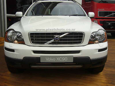 volvos xc90 latest suv closeup photograph from the volvo autoshow at cochin kerala, white suv, mighty muscular suv cars, monster cars, american auto engineering,volvo north american car company