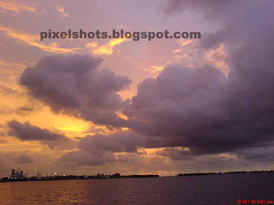 clouds in sunset photograph,heavy rain clouds covering the sky after sunset,after sunset sky,orange coloured sky and clouds