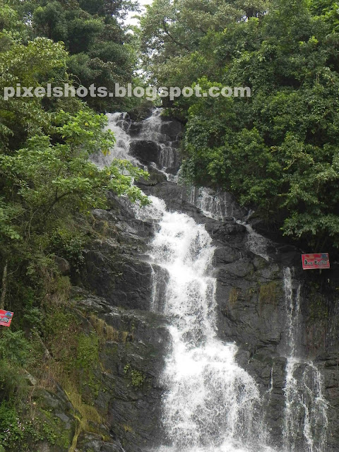stand and pee rock waterfalls,ninnumulli,idukki district waterfalls,kuttikanom waterfalls,mountain stream,waterfalls monsoon kerala,Nikon coolpix p100 photographs,12 mp photos