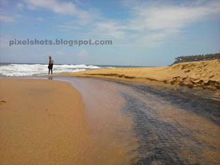 beach river stream,small streams flowing to sea through beach,kerala beach mountain spring,varkala mountain spring,papanasham beach river,hindu holy places,varkala beach specialities