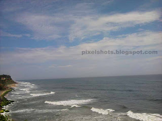 aerial view of varkala beaches from mountain cliffs,kerala beaches birds eye view,beach sea waves viewed from mountains,kerala beaches
