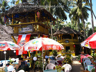kerala coffee house beach cafe,beach side restaurants with watchtower,palm thatched beach hotels,sea side restaurants made of bamboo and palm leaves,affordable beach side hotels in Kerala