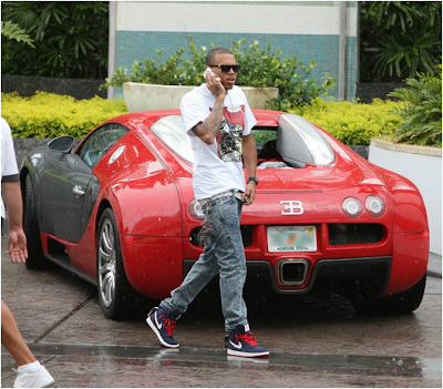 Christopher Bags on Lil Louis Vuitton Coin Pouches As Seen Here With Chris Brown These