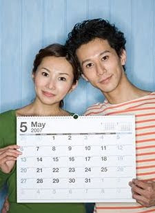 Engaged couple holding calendar