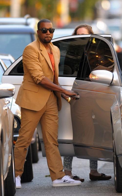 kanye west glasses white. Kanye West in Camel Prada Suit