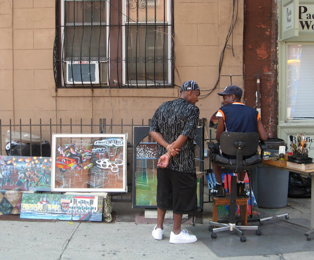 man talking to artist on street
