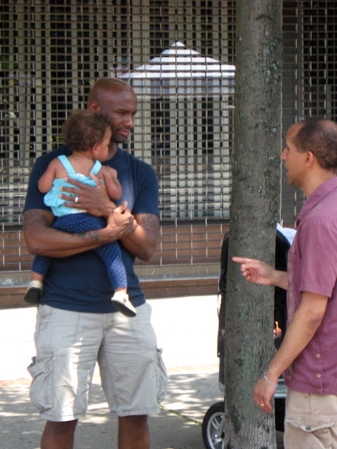 Man holding child at street fair