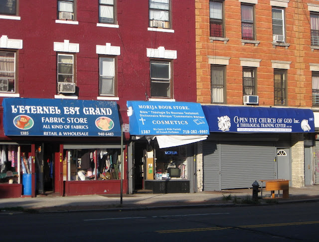 A storefront church, a religious bookstore and a religious fabric store