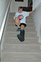 Click for Larger Image of ZoAnn sliding down the stairs