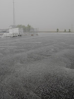 Click for Larger Image of Hail Waves on Parking Lot