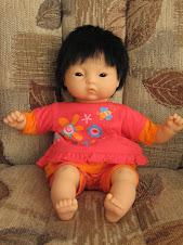 Ta petite poupée asiatique
