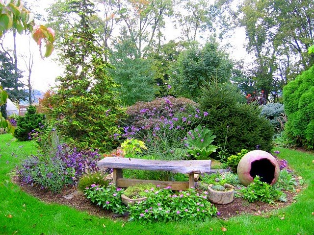 Island and berm gardens on pinterest front yards flower for Backyard flower bed ideas