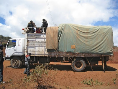 riding on top of cargo truck in northern kenya