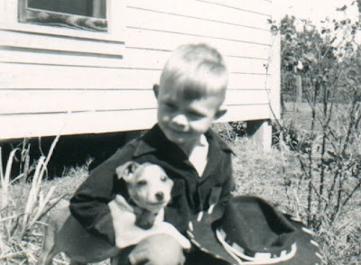 My Dad as a young boy with his pup.