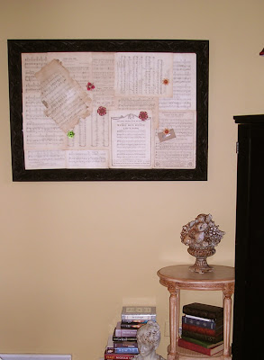 Make a bulletin board with old book pages and vintage sheet music