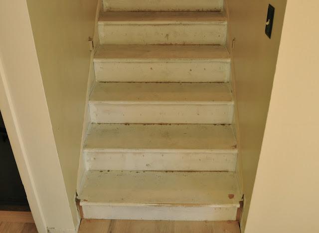 Stair treads before refinishing #stairwaymakeover #paintedrisers