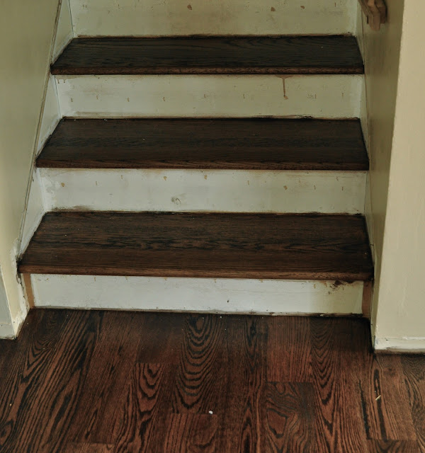Stairway makeover  after staining treads before painting risers.