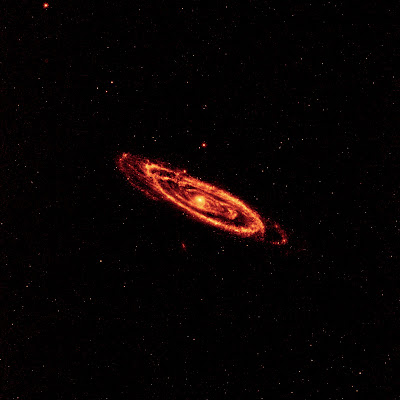 Dust that speckles the Andromeda galaxy's spiral arms in orange and light red.