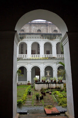 View of inner greenery of courtyard the Dom Basilica in Goa
