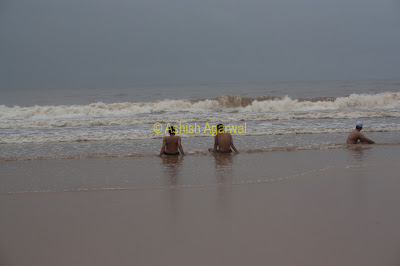 Relaxing at the edge of the water at Baga beach in Goa