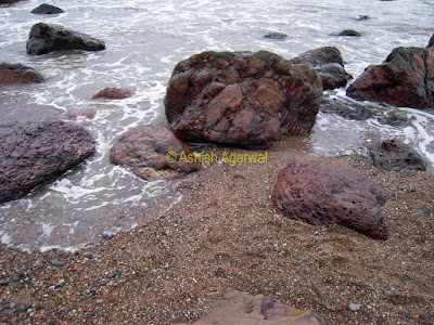 Water lapping the shore of the Arjuna beach in Goa in India