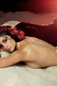 penelope cruz on bed without shirt