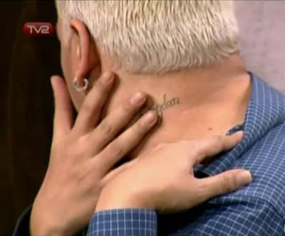 Azis showing his tattoo, with the name of his boyfriend