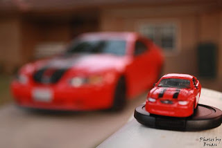 2000 Ford Mustang GT with matching Johnny Lightning Toy Car