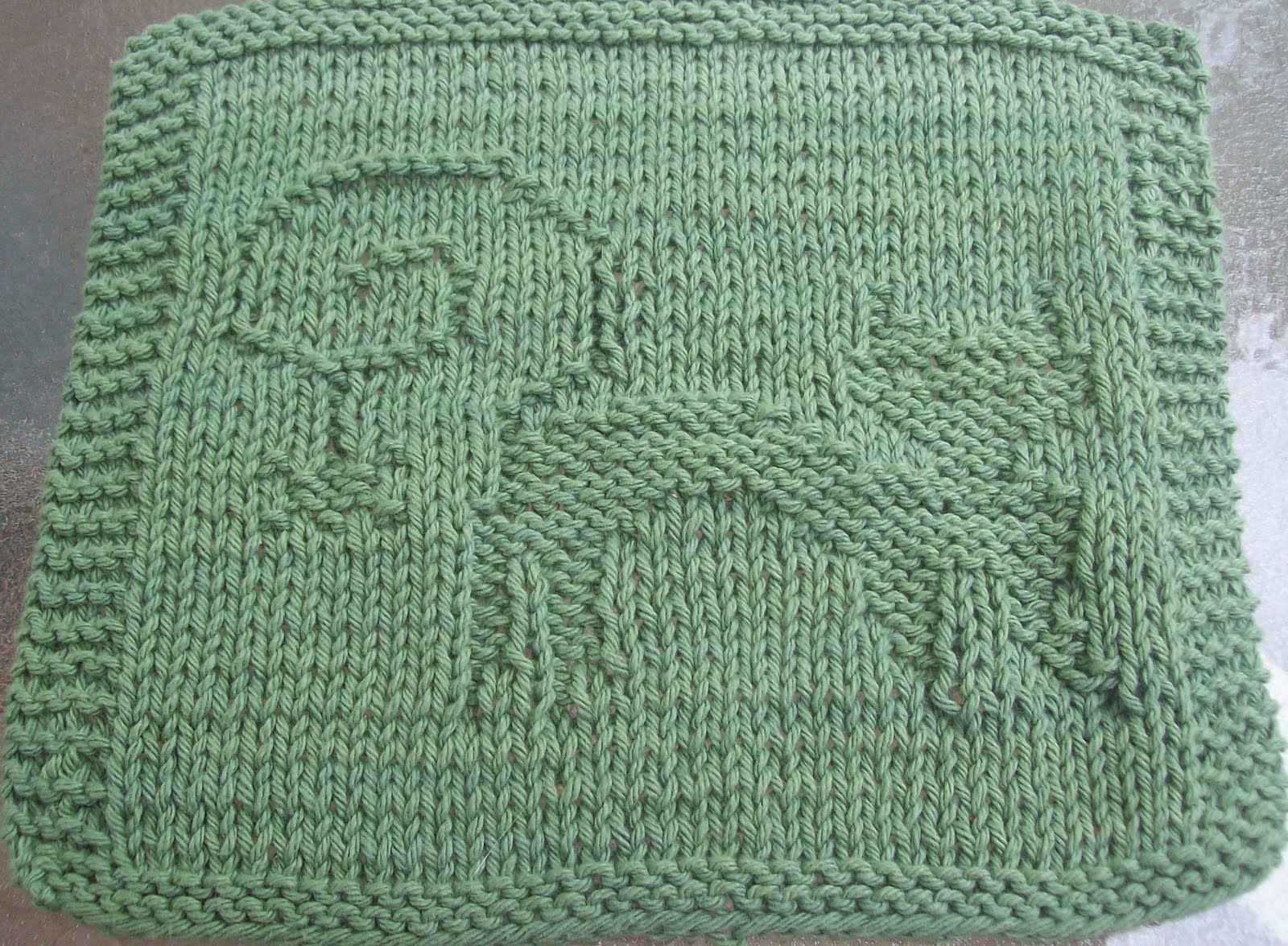 Knitted Dalek Pattern : DigKnitty Designs: Cat With Spider Knit Dishcloth Pattern