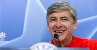 Wenger+press+conf+laughing.jpg