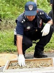 police sorting bone fragments