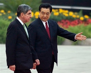 Costa Rica's President Oscar Arias, left, is shown the way by his Chinese counterpart Hu Jintao during the welcoming ceremony outside the Great Hall of the People in Beijing, China, Wednesday, Oct. 24, 2007. Oscar Arias was in the Chinese capital on Wednesday for talks with the country's leaders on his first visit since switching diplomatic ties from Taiwan. (AP Photo/Andy Wong)