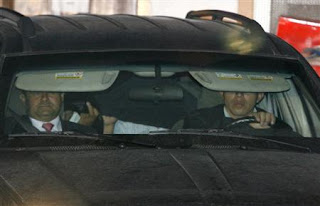 Colombian former senator Mario Uribe (C) covers his face while being escorted by prosecutors after leaving Costa Rica's embassy in Bogota April 22, 2008. (Photo: REUTERS/John Vizcaino)