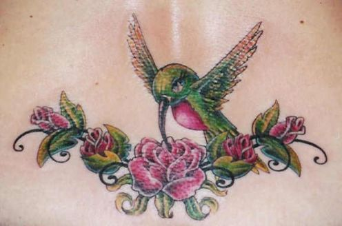Hummingbird tattoos are wonderful little female tattoos when accompanied by