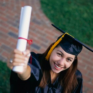 Photo: Graduate celebrating with her Diploma (from Karen's Blog)
