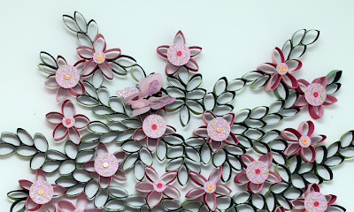 recycling paper: flowers made of tiolet paper rolls on the wall