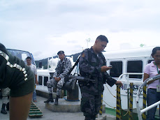 Guarding the fast boat from Masbate to Pilar - The Philippines November 2007