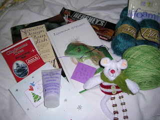 photot of various goodies sent by Secret Pal, including yarn, chocolate and toy mouse