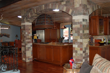 In this remodel design, I used a segmented arch as an architectural element for kitchen entry.