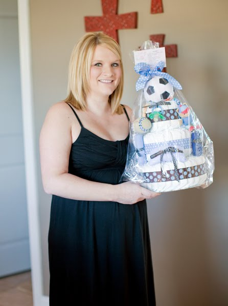 Marie holding her Little All Star Small 3 Tier SGD Diaper Cake