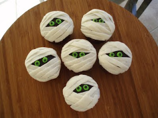 Chocolate mummy cupcakes for the Halloween party!
