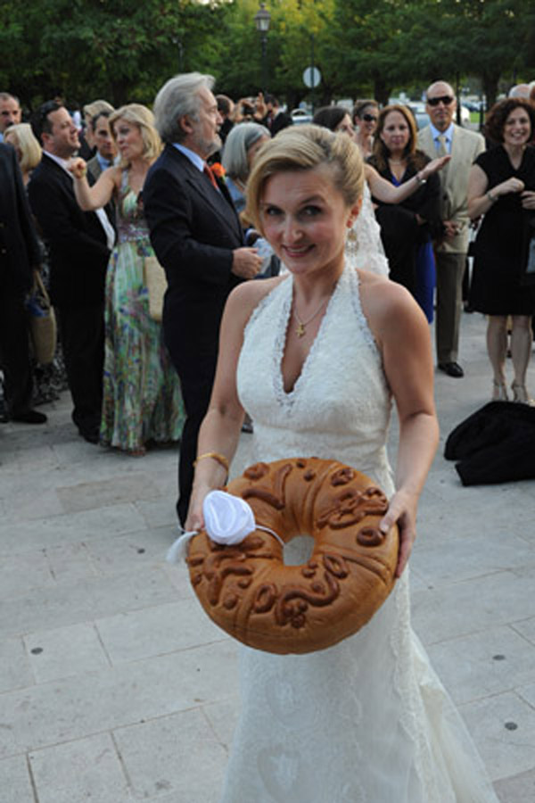 Here you see her at her wedding in Corfu Greece about to toss a decorated