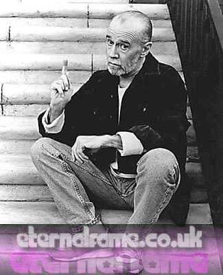 IMAGE: George Carlin sitting on steps