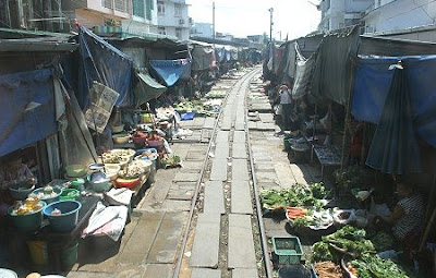 IMAGE: Mae Klong Railway market open for trains