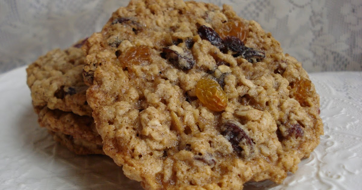 Preheat oven to degrees. Blend oats, flour raisins, cranberries, baking powder, baking soda, and salt; set aside. Beat butter and sugars until light and fluffy. Add egg, cinnamon, and vanilla; beat until combined. Gradually add oat mixture to butter mixture; beat until combined. Combine raisins for topping in separate bowl and set aside.
