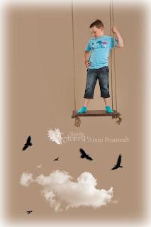 poiss kiigel. Pilved, linnud.