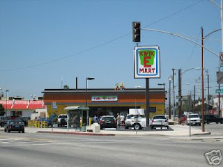Simpsons Movie 7-Eleven Kwik E Mart takeover - store sign